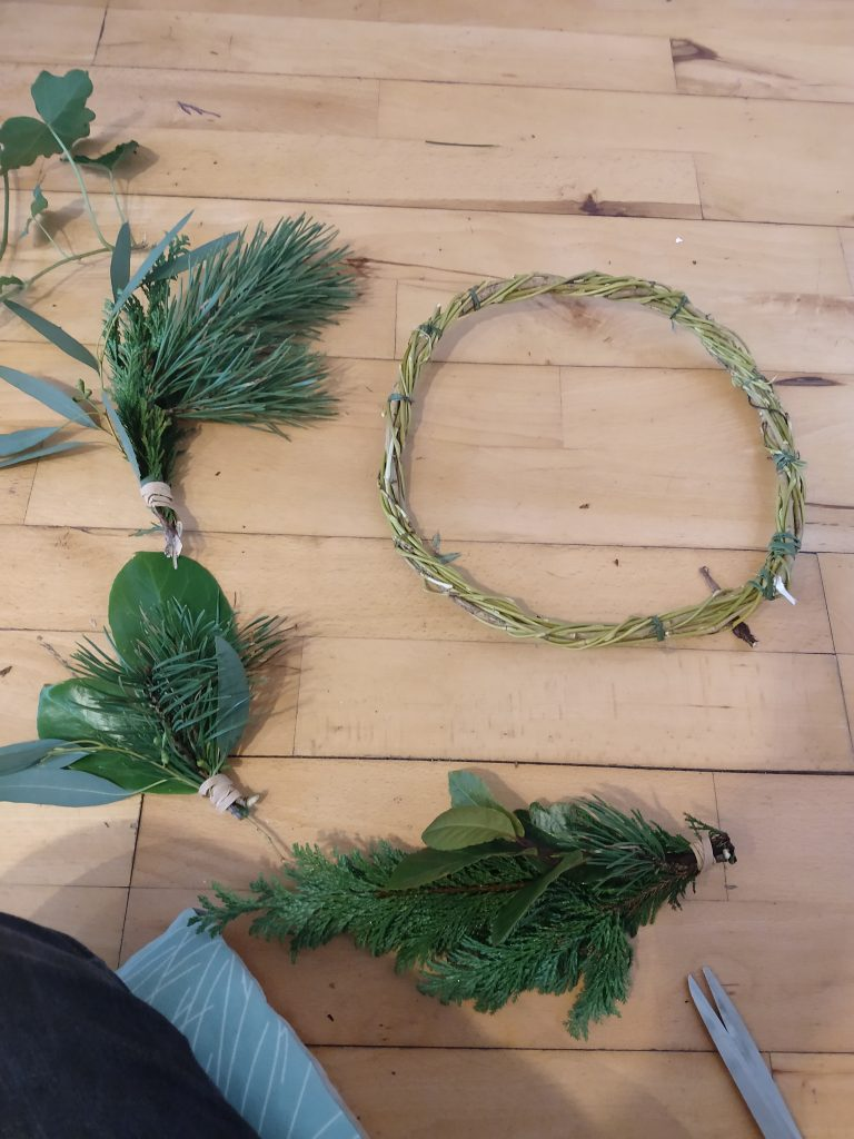 bunches of leaf material and wreath base