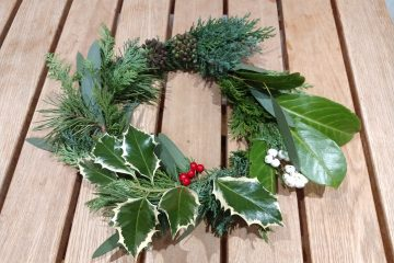 winter wreath showing pine,holly,ivy,laurel